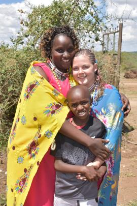 Zoe Dawson poses with charity co-founder Mary Saruni and her son Gadiel (10). PHOTO: SUPPLIED