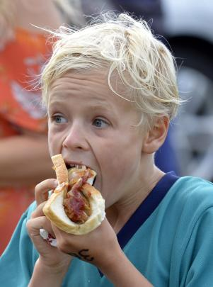 East Taieri School's Matthew Hanna tucks into lunch after finishing his race.
