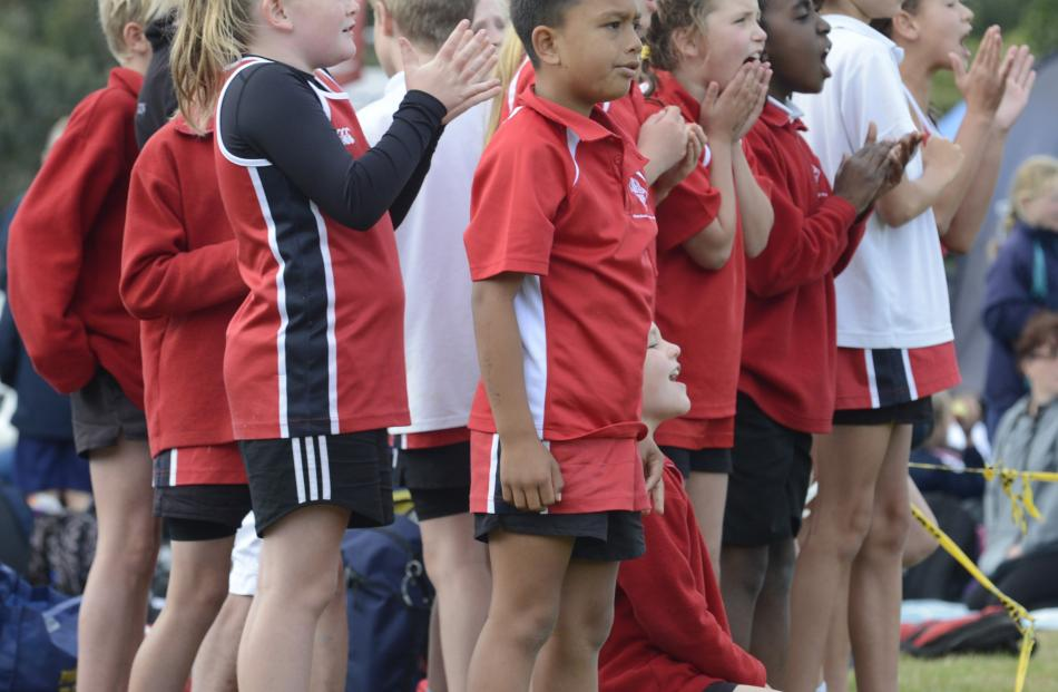 Fairfield School pupils cheer on their school mates.