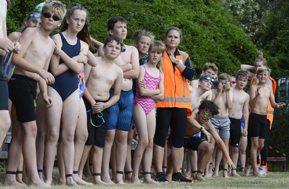 Swimmers look out for their team-mates as they wait their turn.