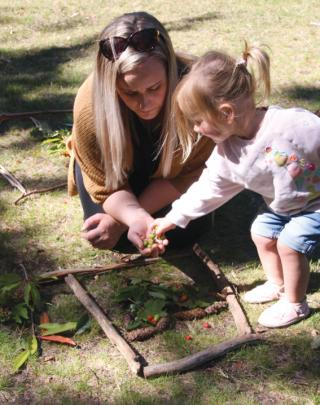 23-month-old Emily Neems of Te Anau enjoying her experience with nature creating her own...