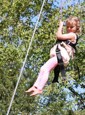 4 year old Lucy Hansen of Te Anau flying through the air on the Flying Fox.