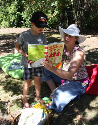 Lisa Sadler of Southern Stars Early Learning centre reading to 4 year old Rafe Woods of Te Anau...
