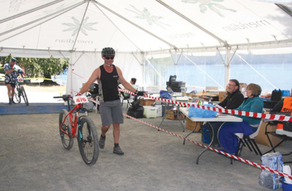 Te Anau Fire Brigade Fire Chief Graeme Moffat slipping through the transition tent at Te Anau...