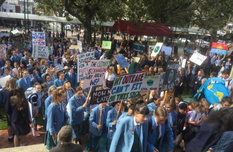 Thousands of Dunedin school pupils have made their way to the Octagon to protest inaction over climate change. Photo: Jono Edwards