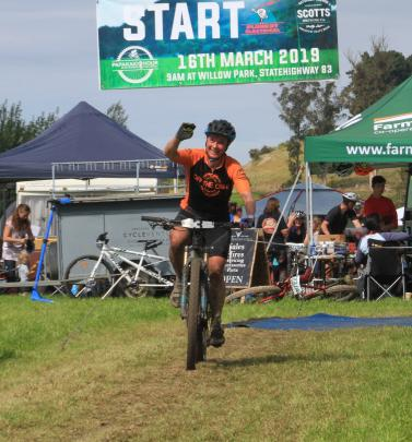 Champion endurance mountain biker Ronel Cook celebrates another lap at the challenge.