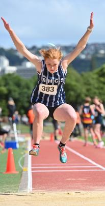 St Hilda's Collegiate's Ella Grayson in mid-air during the under-15 girls triple jump at the...