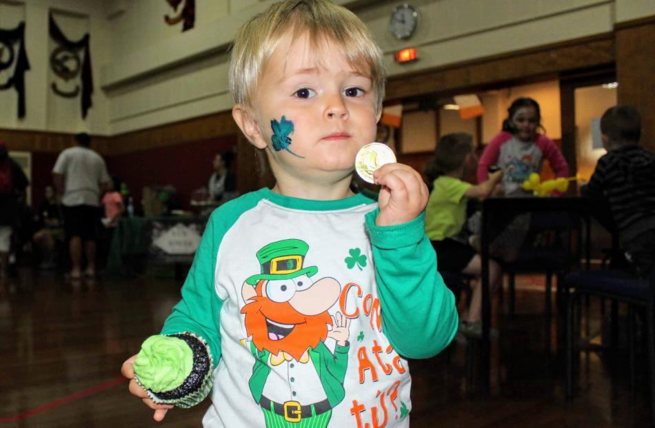 Ted Butson (2) enjoys some Irish themed baking. PHOTO: LUISA GIRAO