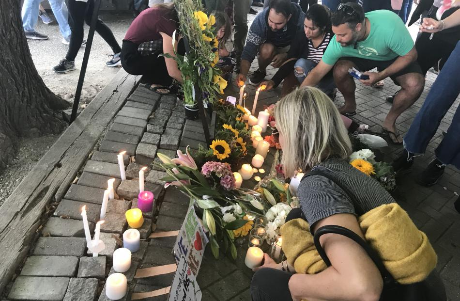 Flowers and candles have been laid out as a tribute to the victims of the Christchurch mosque shootings. Photo: Daisy Hudson