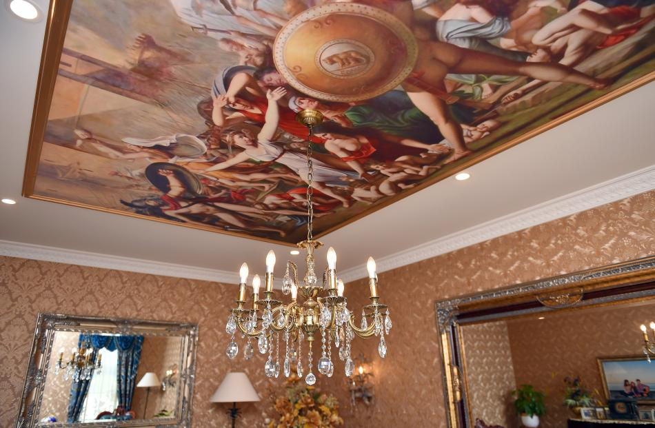 A painting is mounted on the ceiling in one of the living areas.