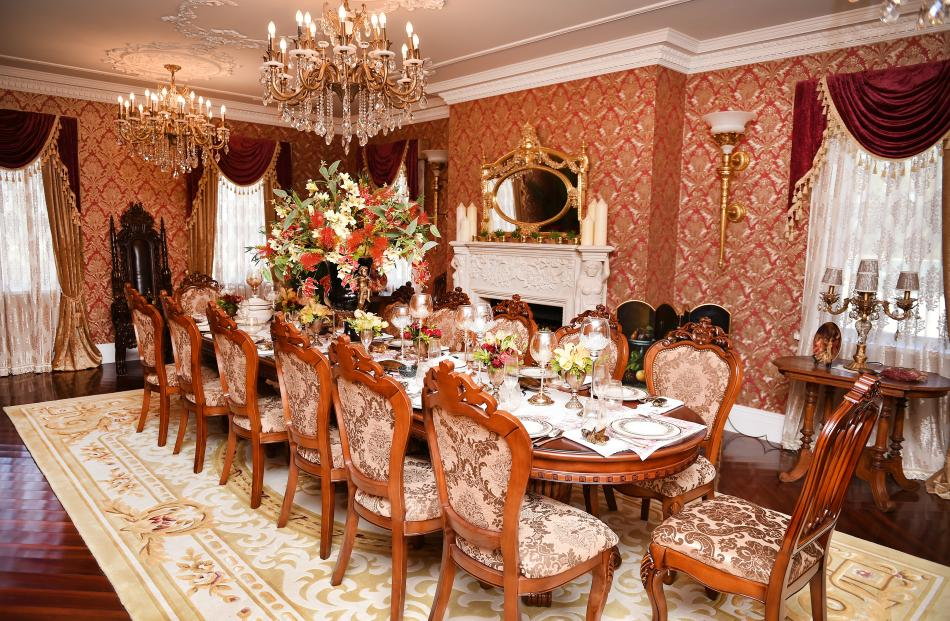 Gold wallpaper lines the banquet room.