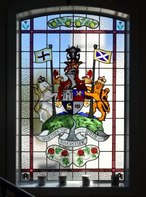 The family crest on the stairwell includes images that represent the owners' forebears.