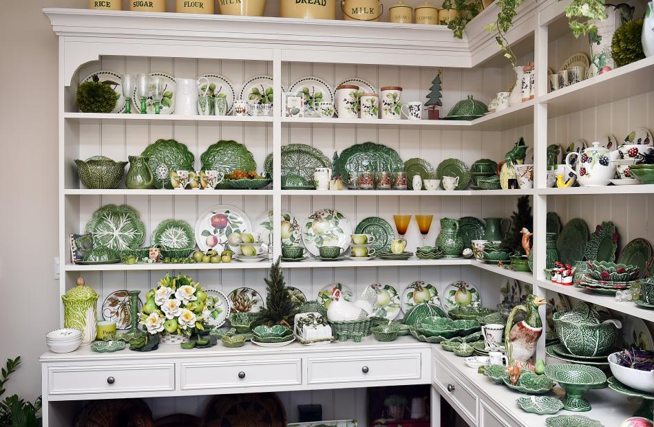 A dresser in the kitchen holds some of Mrs Smith's Portuguese cabbage-ware china, collected over...