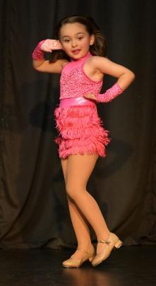 Halaina Sparks (7) performs.