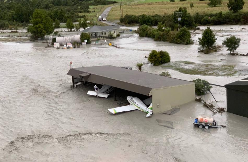 The flood waters have swamped planes in the area. Photo: Wayne Costello, DOC