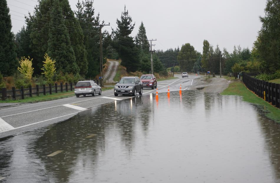 Not for the first time, substantial surface flooding of Aubrey Rd, in Wanaka, blocked off an...