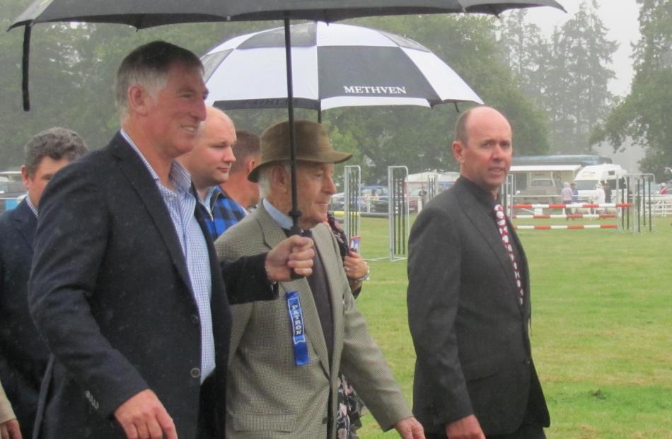Methven A&P Show president Simon Wilson (far right) walks next to patron Michael Poff and...