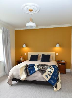 Most of the interior is a warm neutral colour (one-eighth Resene Throndon cream), but wallpapers...