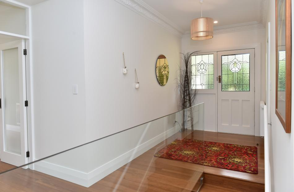 Pretty glass features in the entry. Stairs lead to the large basement, which includes the laundry...