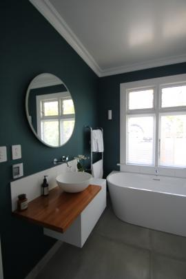 The basin in the family bathroom echoes the circular mirror above it.