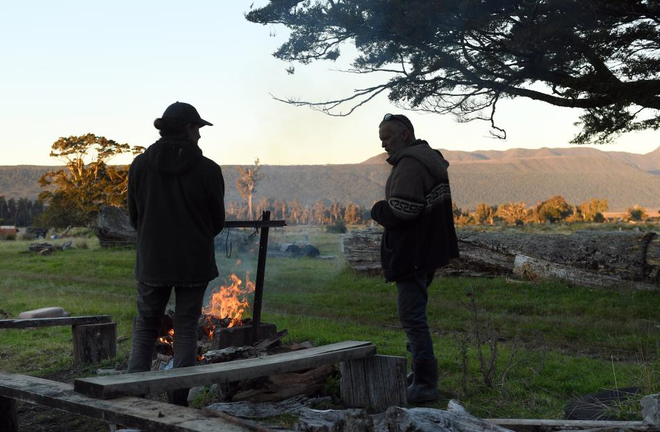 Kathleen Nolan and Oz Macdonald chat over the freshly-set fire.