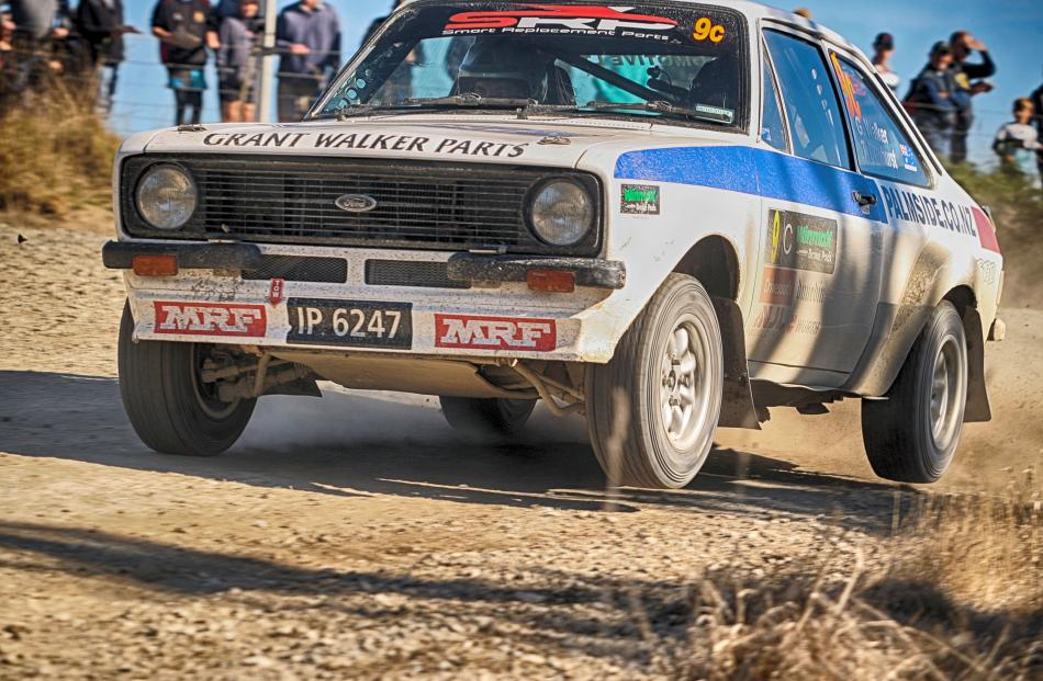 Australians Grant Walker and Tracey Dewhurst get airborne in their Ford Escort RS1800 on Saturday...