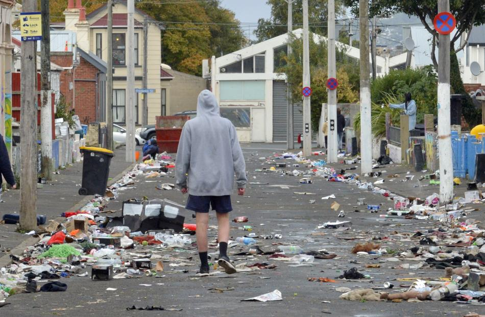 Hyde St residents were up early yesterday to clean up after Saturday's annual street party. PHOTO...