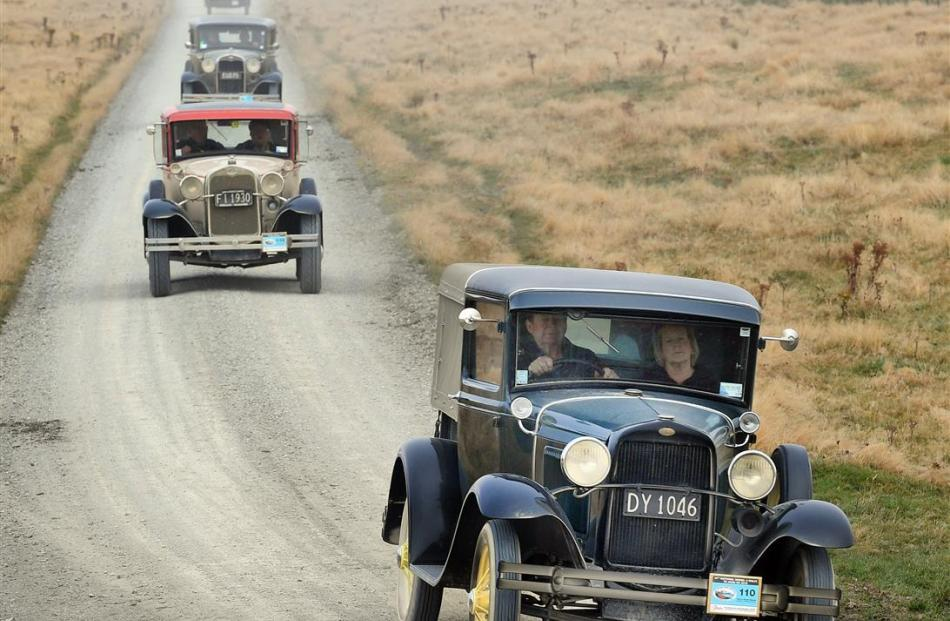 Terry and Carrol Streach, of Christchurch, in their 1930 closed-cab pick-up, lead a group of...