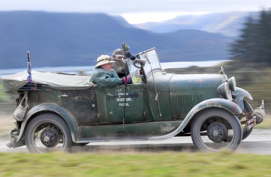 Terry Castello with passenger Ross Bolton, both of Christchurch, shoot the breeze as they cruise...