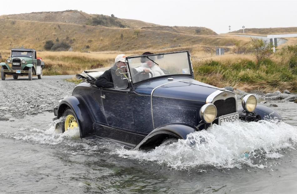 Jock and Shirl Burridge, of Nelson, drive their 1930 Roadster through a creek en route to Walter...