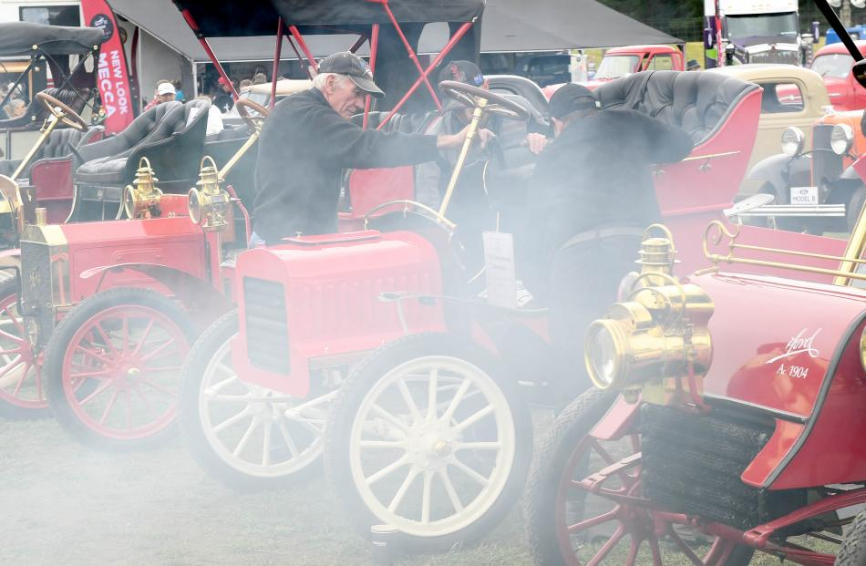 Ian Ridd, of Winton, helps start a 1904 Ford Model C runabout from Invercargill's Bill Richardson...