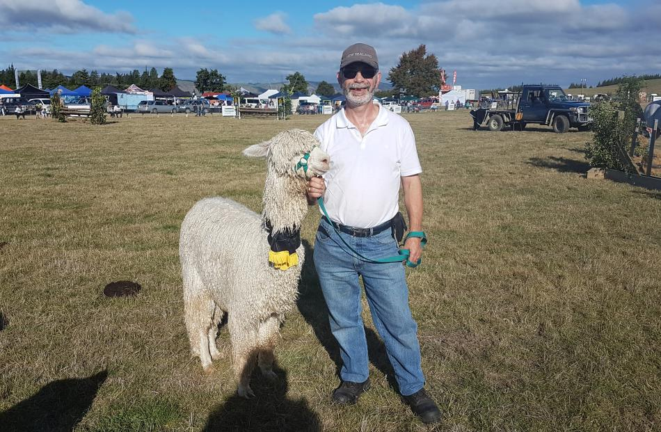 Neil Godfrey with his alpaca which won the FMG Supreme Livestock Exhibit over the show and Supreme Alpaca Champion prize.