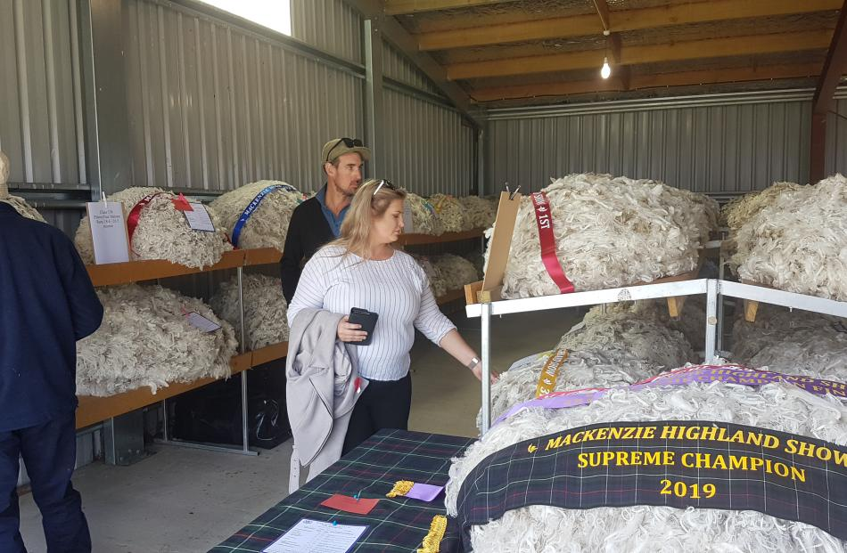 Show attendees check out the champion fleeces, including the supreme champion fleece from Grays...