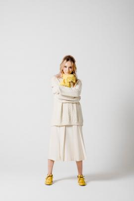 ''The Aran handknit Jersey and New Zealand-made cream wool pleat skirt with vibrant pop yellow,...