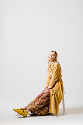 ''The earthy shades of the vintage Cue cotton velveteen coat and heavily embroidered drawstring...