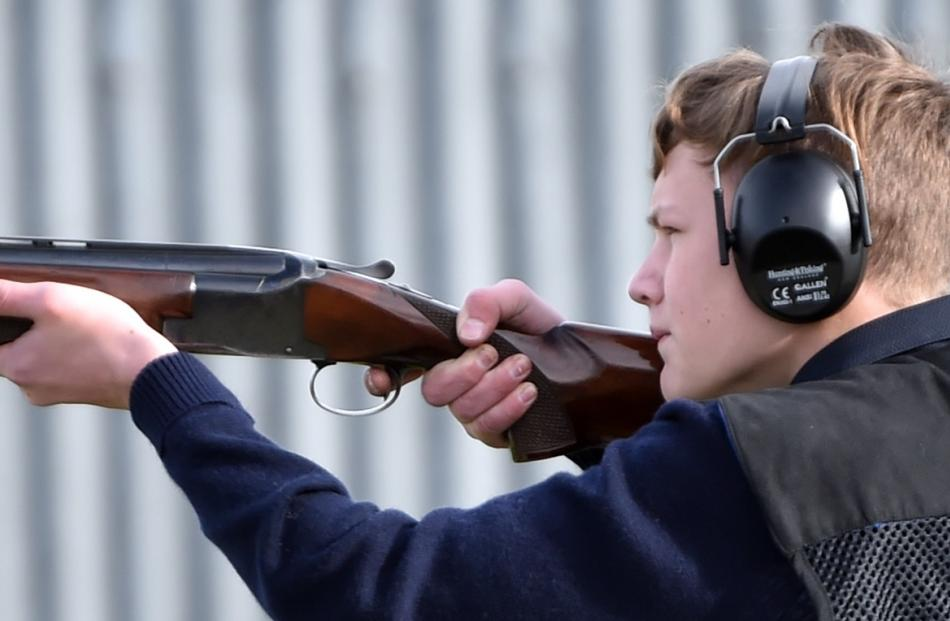 King's High School trap shooter Ted Cottle (13) takes aim in the trap shooting contest at the...