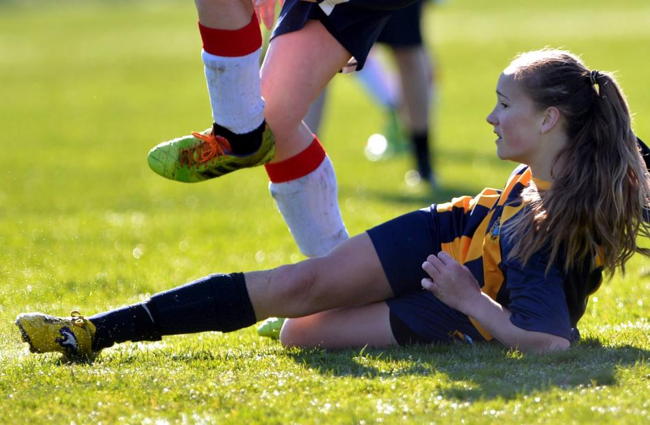 Wakatipu High School's Elsie Anderson makes a tackle on the ground during a school football match...