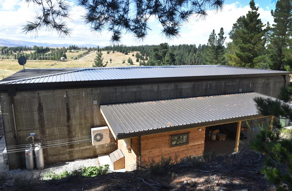 Pasture and pine trees surround the former bunker, which has had a mud room, laundry and carport...