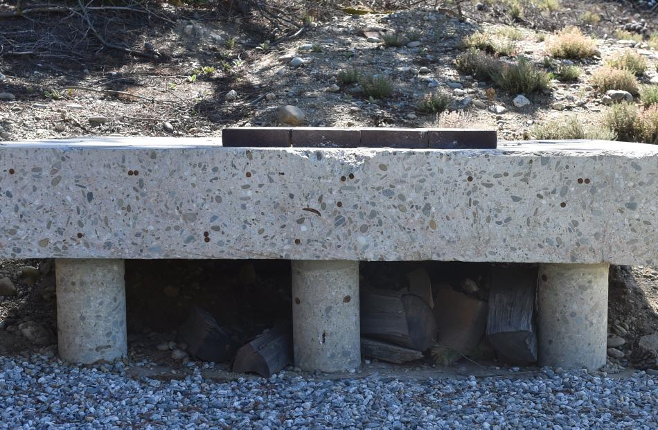 A piece of the back wall that was removed when the carport and laundry were added. This concrete...