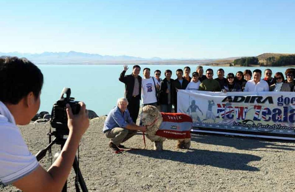 Posing for tourists' photo albums with John Perriam at Lake Pukaki.