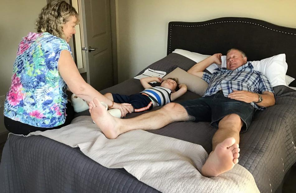 Harry Finch gets attention from grandparents Sue and Gerald Harrex. PHOTOS: SUPPLIED