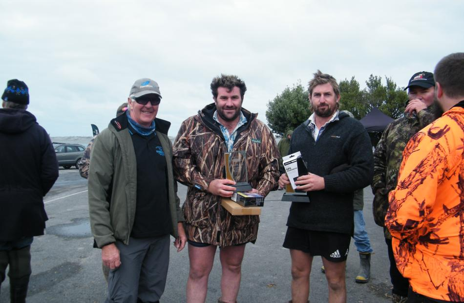Little Rakaia Boating Club president Graeme Patterson (left) presented prizes for the Poker Run...