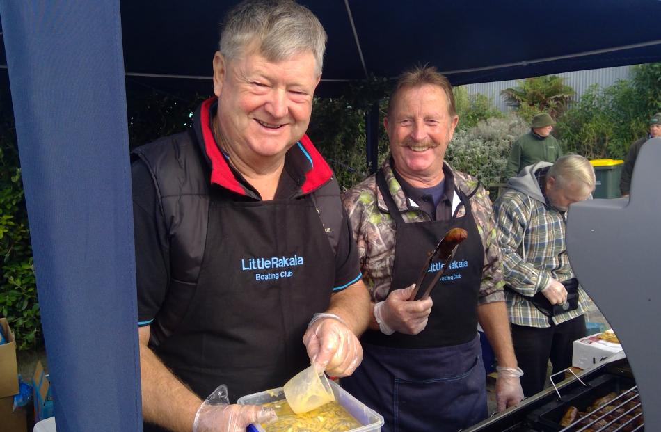 Volunteers (from left) Tony Julius, Ross Turner, and Graeme Gurdon man the barbecue.