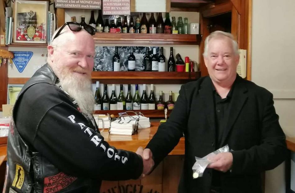 Patriots Deep South President Phil Herriott presents a $1000 donation to Waimate Mayor Craig...