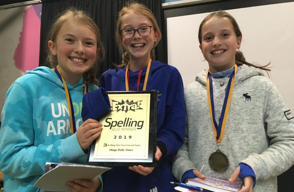 Celebrating their triumph in the year 5 and 6 spelling quiz last night are Arrowtown School...