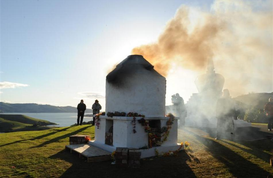 Smoke rises from the stupa. Photos by Stephen Jaquiery.