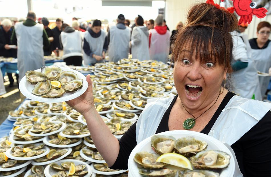 Estelle Leask, of Bluff, displays some of the 2000 dozen raw Bluff oysters at the Barnes stand.