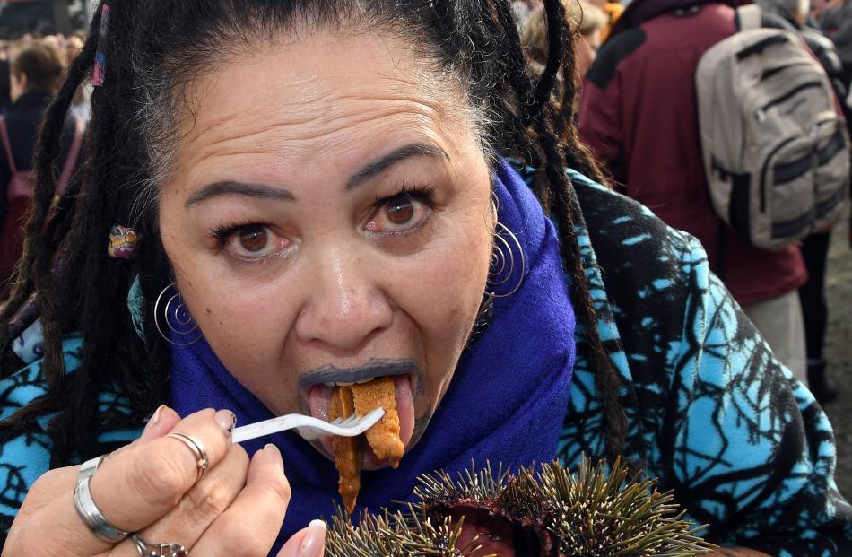 Gaylene TeHore, of Blenheim, eats some kina