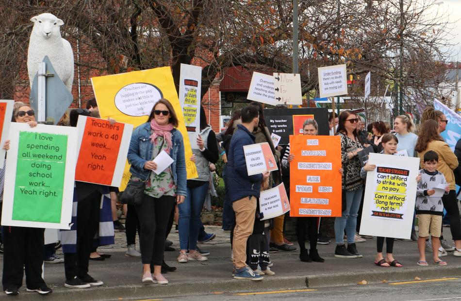 Gore: About 150 teachers and supporters - including 25 children - gather and march in Gore's Main St. Photo: Sandy Eggleston