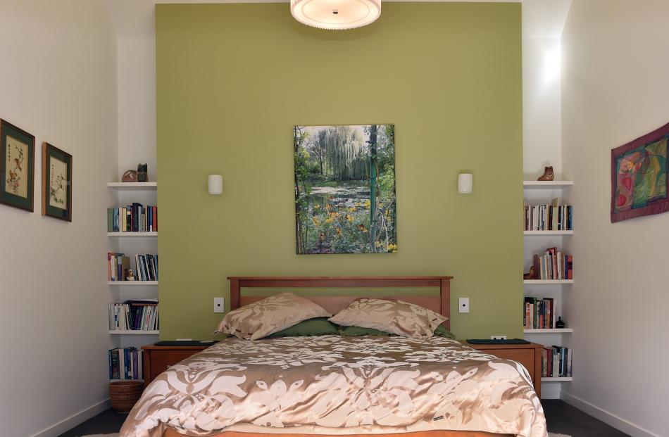 A photo Dr Hood took on her phone of Monet's garden in Giverny, France, hangs above the bed....